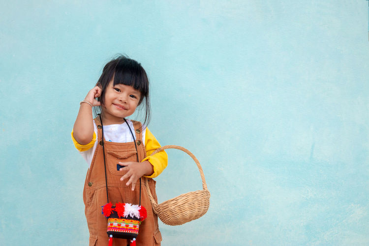 Childhood One Person Child Girls Standing Basket Front View Holding Women Smiling Cute Container Leisure Activity Females Casual Clothing Innocence Looking At Camera Real People Bangs Hairstyle