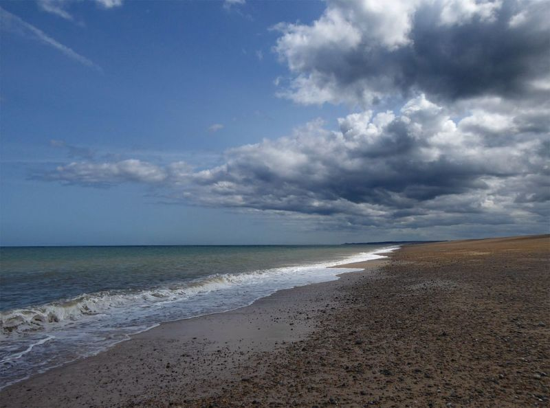 Summertime sky at Cley Sea Beach Sky Sand Horizon Over Water Nature Beauty In Nature Tranquility Scenics Cloud - Sky Tranquil Scene Water Day No People Outdoors Wave Moody Sky Cley Next The Sea Norfolk Uk