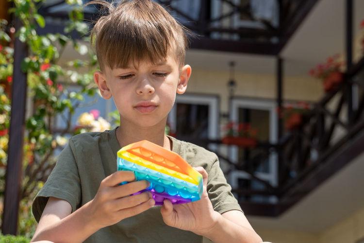 Portrait of boy holding ice cream