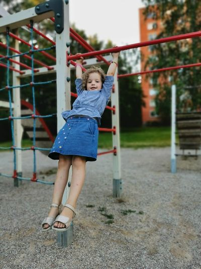 Full length of cute girl playing in playground