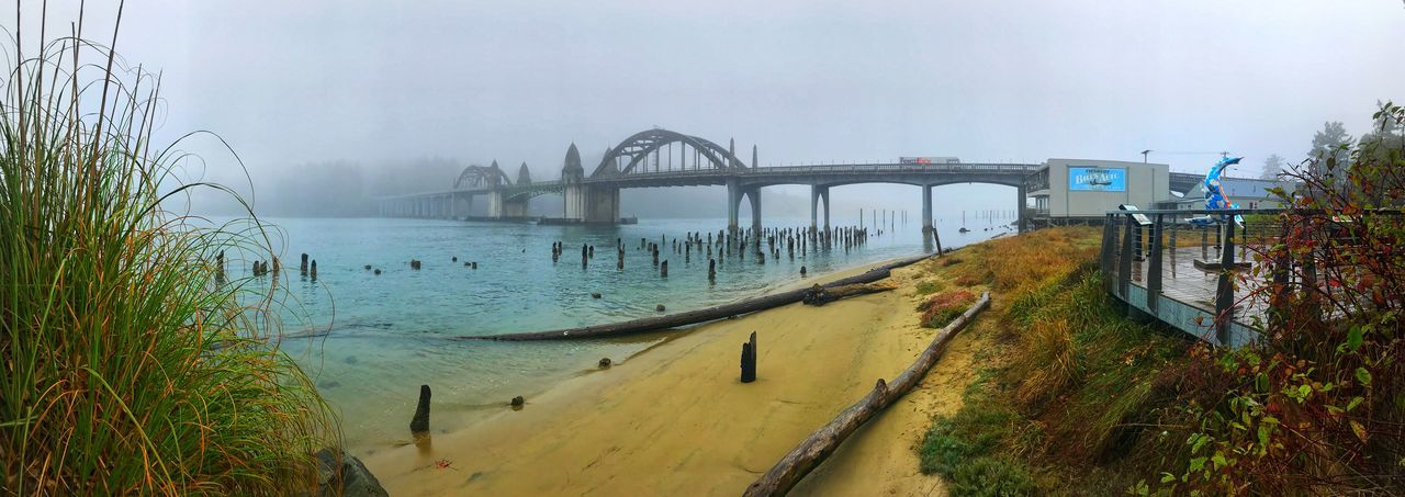 Siuslaw River Bridge in the fog from Florence, Oregon. Bridge Water Bridge - Man Made Structure Built Structure Transportation Architecture Connection Nature Fog Panoramic Plant Mode Of Transportation Sky Day No People Arch River Outdoors Arch Bridge Siuslaw River Siuslaw River Bridge Panoramic