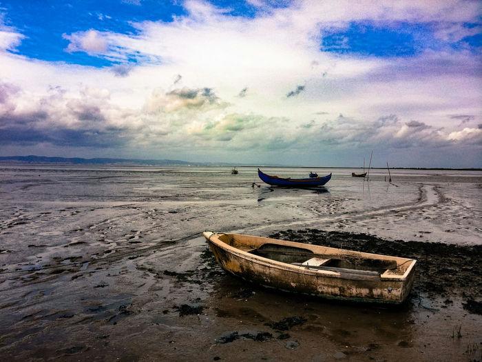 Abandoned boats on shore