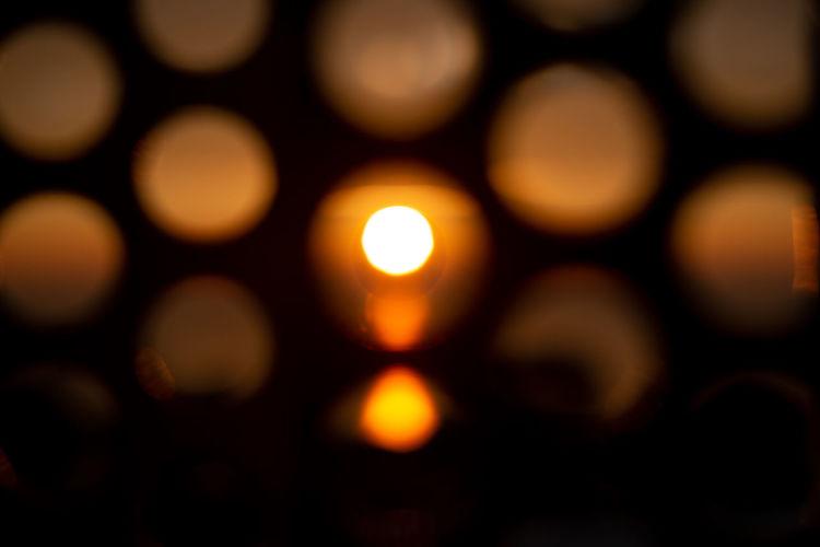 Sunset light patterns Illuminated Defocused Full Frame Backgrounds No People Circle Night Geometric Shape Lighting Equipment Shape Glowing Close-up Large Group Of Objects Pattern Light Selective Focus Indoors  Light - Natural Phenomenon Orange Color Motion Sunsets Sunset