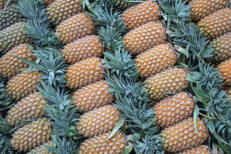 Pineapple fruit. Backgrounds Close-up Day Food Food And Drink Freshness Fruit Full Frame Green Color Healthy Eating Large Group Of Objects Market Nature No People Pineapple Tropical Fruit Yellow
