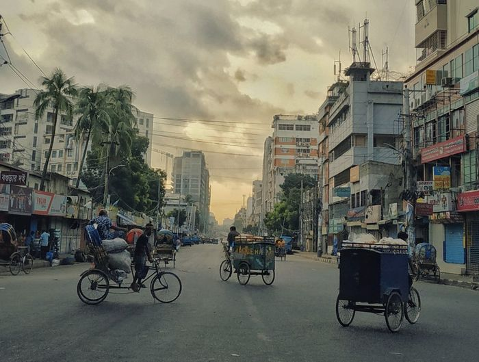 Good morning world City Cityscape Tree Bicycle City Life Cycling City Street Street Sky Architecture Urban Road Rickshaw Tricycle Jinrikisha Moving Urban Skyline Skyscraper Office Building Downtown District Elevated Road