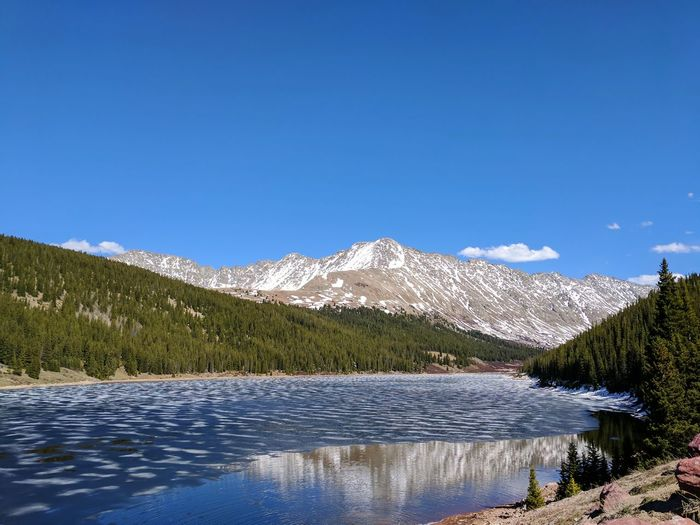 Spring thaw Lake Melting Ice Thaw Seasons Summer Spring Tree Mountain Clear Sky Snow Lake Pinaceae Water Blue Pine Tree Forest Snowcapped Mountain Coniferous Tree Mountain Peak Mountain Range Rocky Mountains