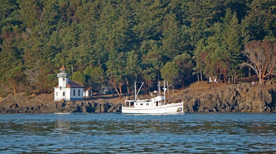 island hopping Boating Trawler San Juan Islands Harbor Resort Naval Architecture Luxury Coastline Coast Lighthouse Passage Canals And Waterways Island Seascapes Motor Vessel Salish Sea Nautical Vessel Mode Of Transportation Sea Nature Travel Architecture Outdoors Waterfront Built Structure Forest Scenics - Nature Passenger Craft Luxury Beauty In Nature