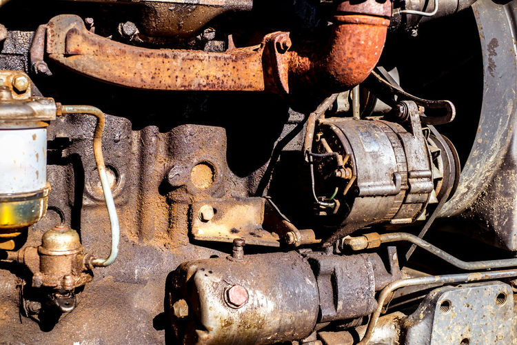 tractor dirty engine close up Tractor Dirty Engine Close Up Engine Metal Rusty Machinery Old Abandoned Damaged Decline Deterioration Obsolete No People Run-down Close-up Mode Of Transportation Transportation Machine Part Day Bad Condition Weathered Iron - Metal Industrial Equipment Ruined