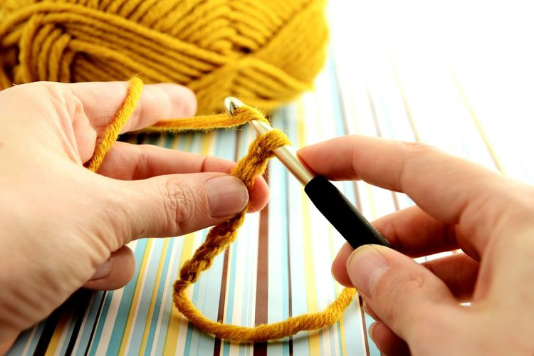 Cropped Image Of Woman Crocheting Wool