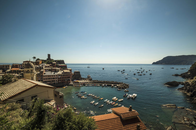 Buildings by sea against sky at cinque terre