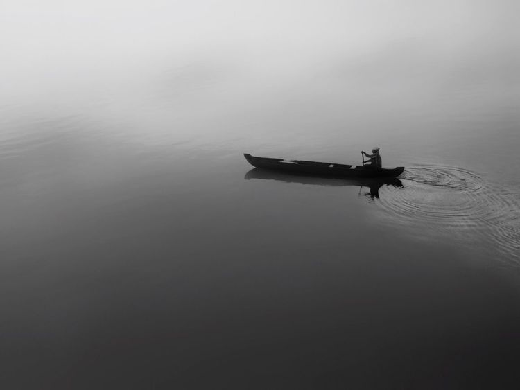Searching for life in the middle of nowhere Fishing Fishinglife . Transportation Water Mode Of Transport Nature Outdoors Beauty In Nature Blackandwhite Blackandwhite Photography Black And White Black And White Collection  Boat Kerala