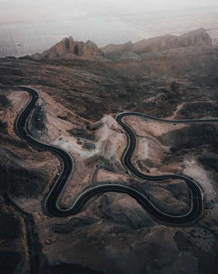 Winding roads in the desert. Desert Abu Dhabi Dubai Emirates No People High Angle View Nature Land Tranquility Water Full Frame Beauty In Nature Pattern Day Close-up Tranquil Scene Environment Textured  Simplicity