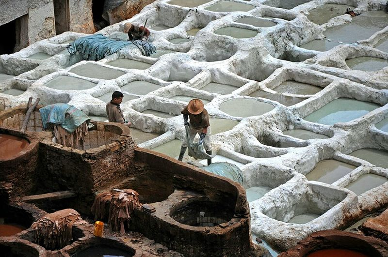 Telling Stories Differently This is one of the many Stages of Leather Processing In Order for the Final Product to reach the Markets. Pattern Pieces Men At Work  Working Hard Hardwork Handmade Men Of EyeEm Photojournalism Tanneries View From Above Patterns Pattern, Texture, Shape And Form The Architect - 2016 EyeEm Awards - Medina De Fez Tannerie In Fez Les Tanneries Morocco