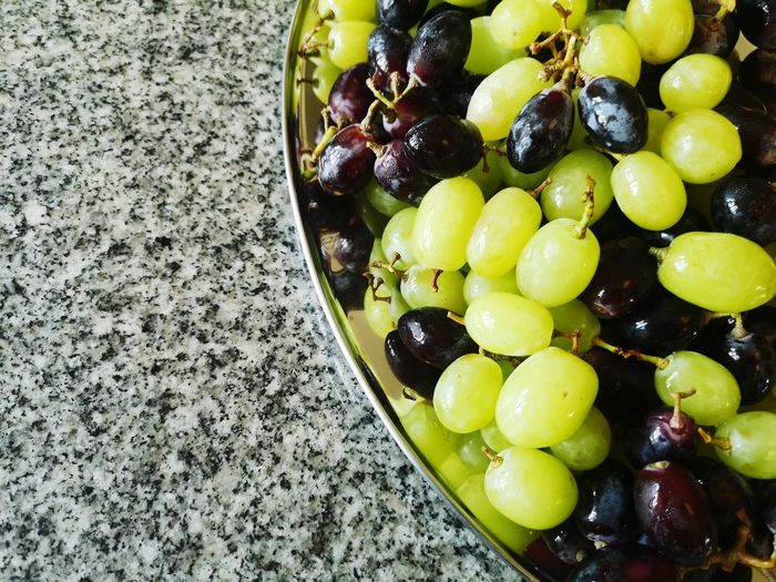 High angle view of grapes in bowl