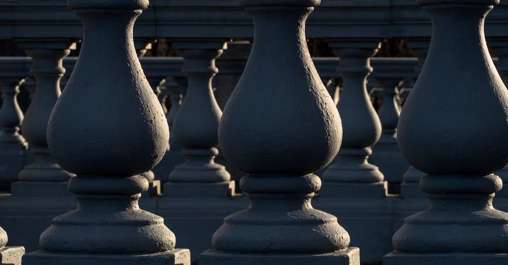 Close-up of baluster in church on sunny day
