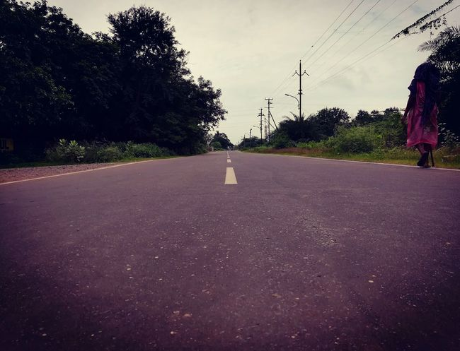 Road Outdoors Cloud - Sky Day India Indian Indianstories Incredible India Indiaclicks Sky Tree Empty Road Highway Highwayphotography Highwayphotos Journey Journeyphotography Journey Destination Woman Villager Villagers Nature Beauty In Nature