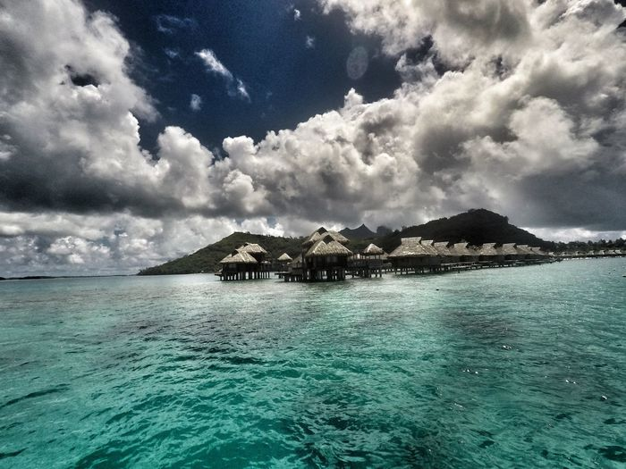 Overwater Bungalow Clouds And Sky Nature BoraBora Resort Clearwater Traveller No People Scenics Sea Beauty In Nature Water Outdoors Sky Tranquility Summer