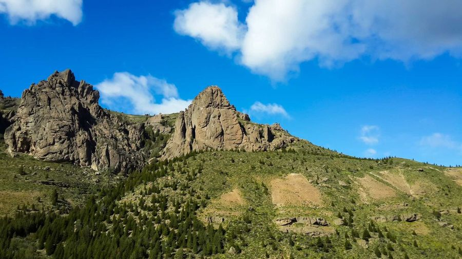 Cluody Sky, near to Esquel, Chubut, Argentina. Beauty In Nature Blue Clear Sky Day Forest Geology Hiking Horizontal Landscape Mountain Nature No People Outdoors Pine Woodland Rock - Object Scenics Sky Summer Vacations