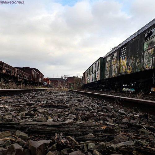 Railroad tracks by train against sky