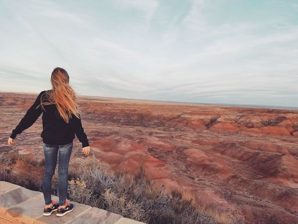 Walking Women Sand Outdoors Journey Rear View Vacations Landscape Travel Destinations The Way Forward Adventure Beauty Arizona Desert Vibes Arid Climate Tranquil Scene Tranquility Nature Dramatic Sky Sunset Petrified Forest National Park Desert Scenics Hiking