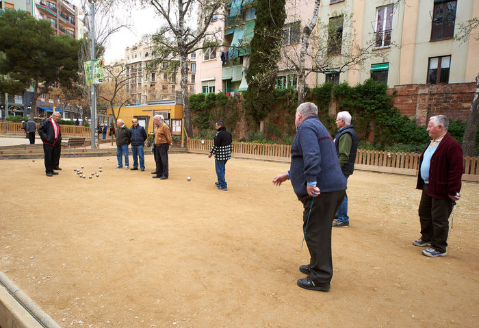 Barcelona, Spain - April 4, 2016: Petanque players in the park of Barcelona. Petanque is a game where the goal is to toss hollow steel balls as close as possible to a small wooden ball. Spain Active Activity Adult Adults Only Barcelona, Spain Challenge City Day Editorial  Europe Full Length Fun Game Group Of People Men Outdoors Park Pensioners People Petanque Pétanque Players Real People Sand Senior Men SPAIN