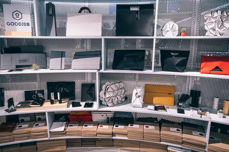 Interior design of a hipster store with different items displayed on shelves. Boutique Business Center Fashion Light Market Activity Buying Clothing Color Consumerism Customer  Design Display Equipment Hipster Hipster-interior Hipster-store Indoors  Interior Mall Rack Retail  Row Sales