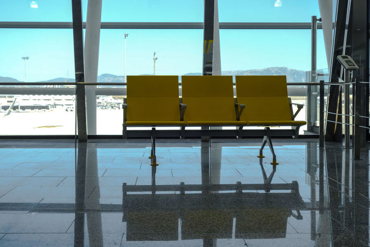 Airport Architecture Bench Blue Flughafen Modern No People Reflection Seating Sitz Sitzbank Sky Terminal Urban Waiting Waiting Room Yellow