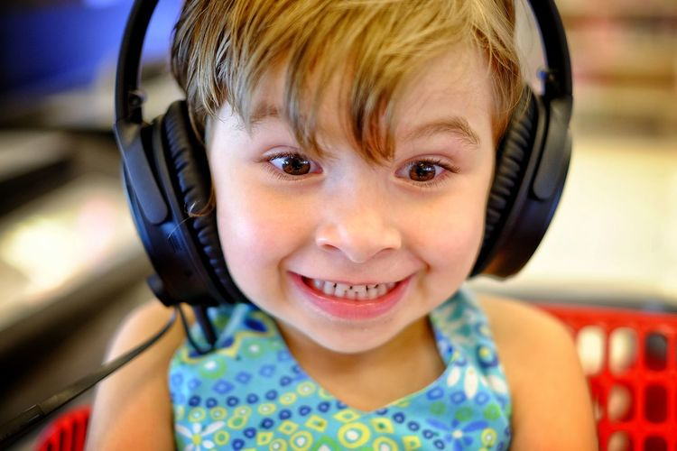 Close-up of girl listening music with headphones