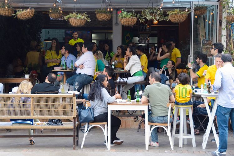 Bar - Drink Establishment Street Photography Group Of People Food And Drink World Cup World Cup 2018 Streetphotography Real People City Urban Large Group Of People Architecture Sitting Cafe Table Seat City Business Food And Drink Lifestyles Chair Crowd