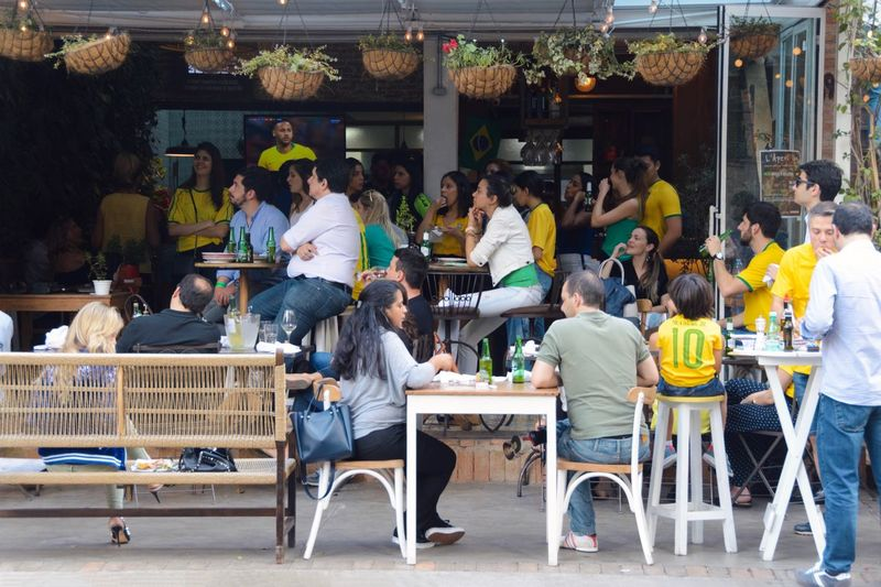 Bar - Drink Establishment Street Photography Group Of People Food And Drink World Cup World Cup 2018 Streetphotography Real People City Urban Large Group Of People Architecture Sitting Cafe Table Seat City Business Food And Drink Lifestyles Chair Crowd Love The Game