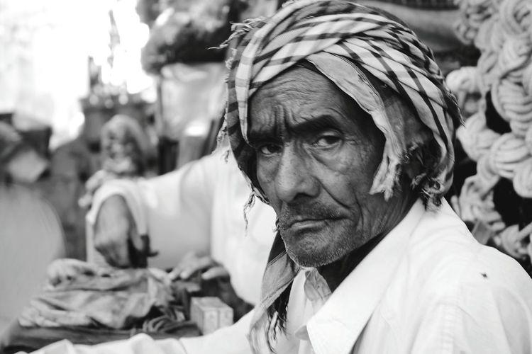 Portrait of senior man wearing headscarf