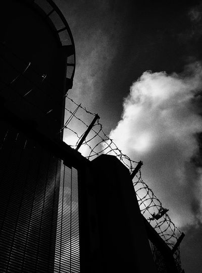 Black & White Barbed Wire Clouds Low Angle View Architecture Built Structure Sky No People Day Building Exterior Outdoors