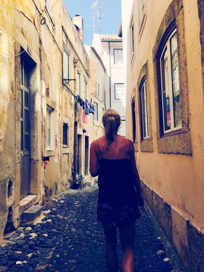 Built Structure Architecture Building Exterior Real People Rear View One Person The Way Forward Lifestyles Day Building Full Length Outdoors Women
