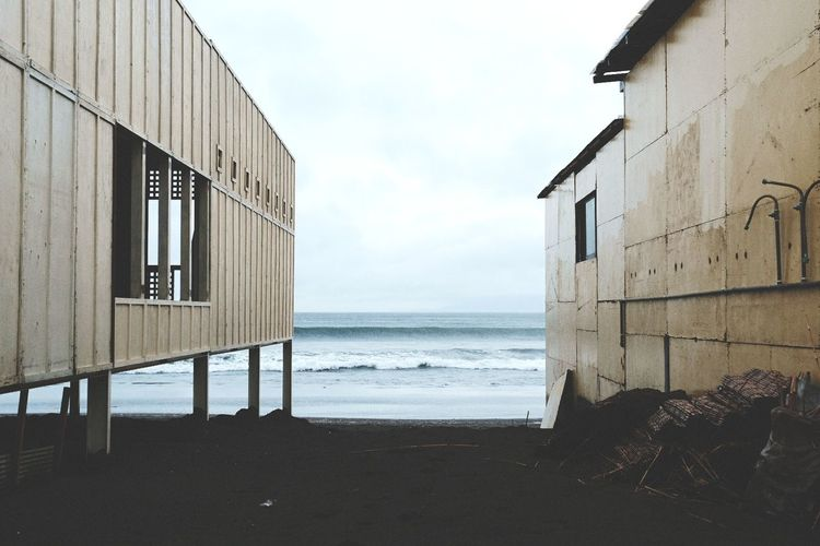 Built Structures By Sea Against Sky
