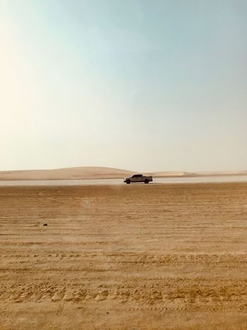 Arabian Moment Land Sky Sand Mode Of Transportation Scenics - Nature Transportation Horizon Non-urban Scene Water Land Vehicle Desert Tranquility Off-road Vehicle No People Copy Space Beauty In Nature Day Tranquil Scene Sea Nature