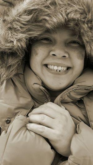 Portrait Of Cheerful Woman Wearing Fake Fur