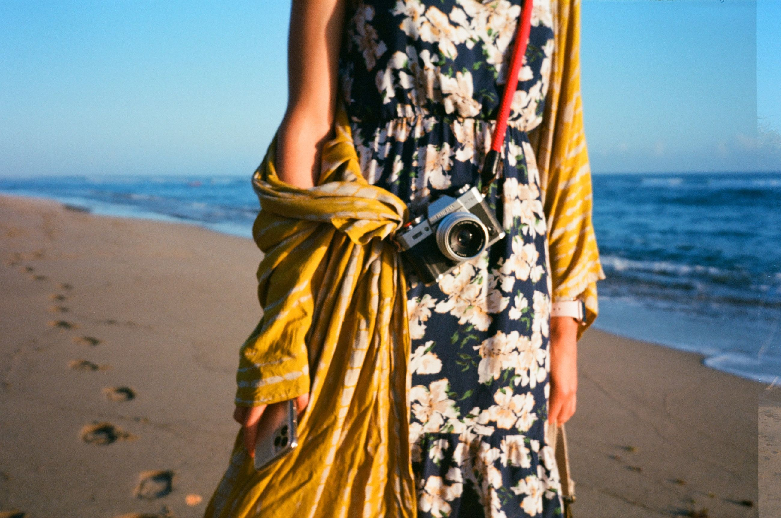 sea, yellow, beach, land, dress, water, sky, one person, adult, horizon, spring, horizon over water, nature, fashion, women, midsection, standing, clothing, day, photo shoot, sand, vacation, trip, leisure activity, outdoors, focus on foreground, day dress, beauty in nature, sunlight, holiday, young adult, tranquility, travel destinations, female, travel, lifestyles, rear view, summer, scenics - nature, pattern, person, sunny