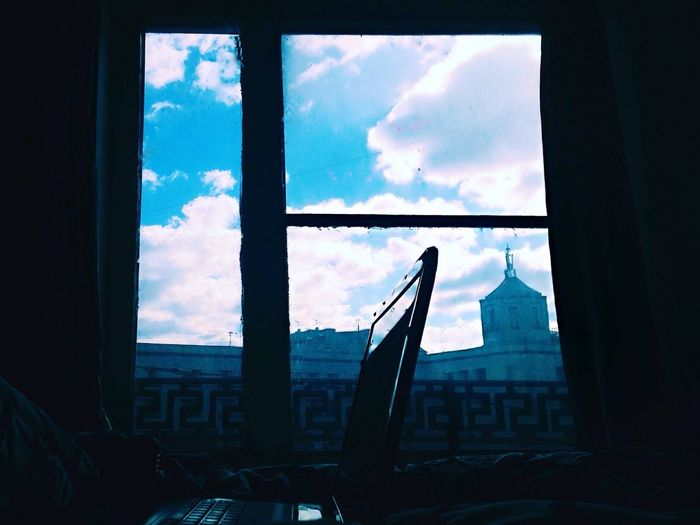 Window Indoors  Transparent Glass - Material Sky Architecture Built Structure Cloud City Building Exterior Cloud - Sky Glass Dark Scenics No People Work Working Showyourwork Laptop Notebook Clouds And Sky Windows Bedroom