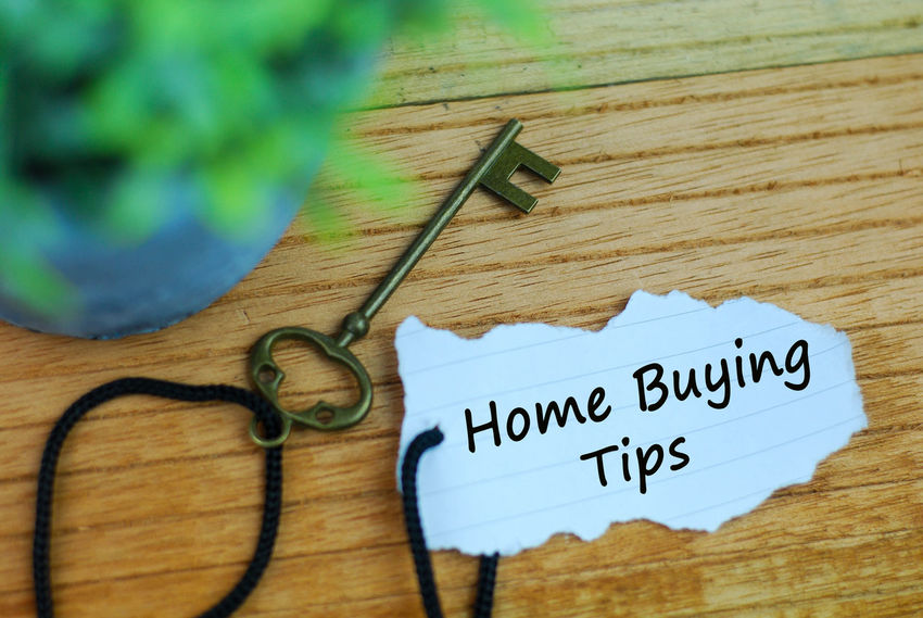 House key and torn paper with word home buying tips on wooden background Loan  Agent Bank Close-up Communication Day Developer Green Color High Angle View Indoors  Investment No People Paper Property Real Estate Table Text Tips Western Script Wood - Material
