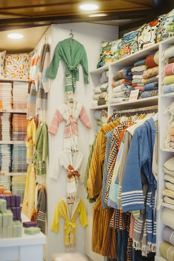 Rear view of clothes for sale in store