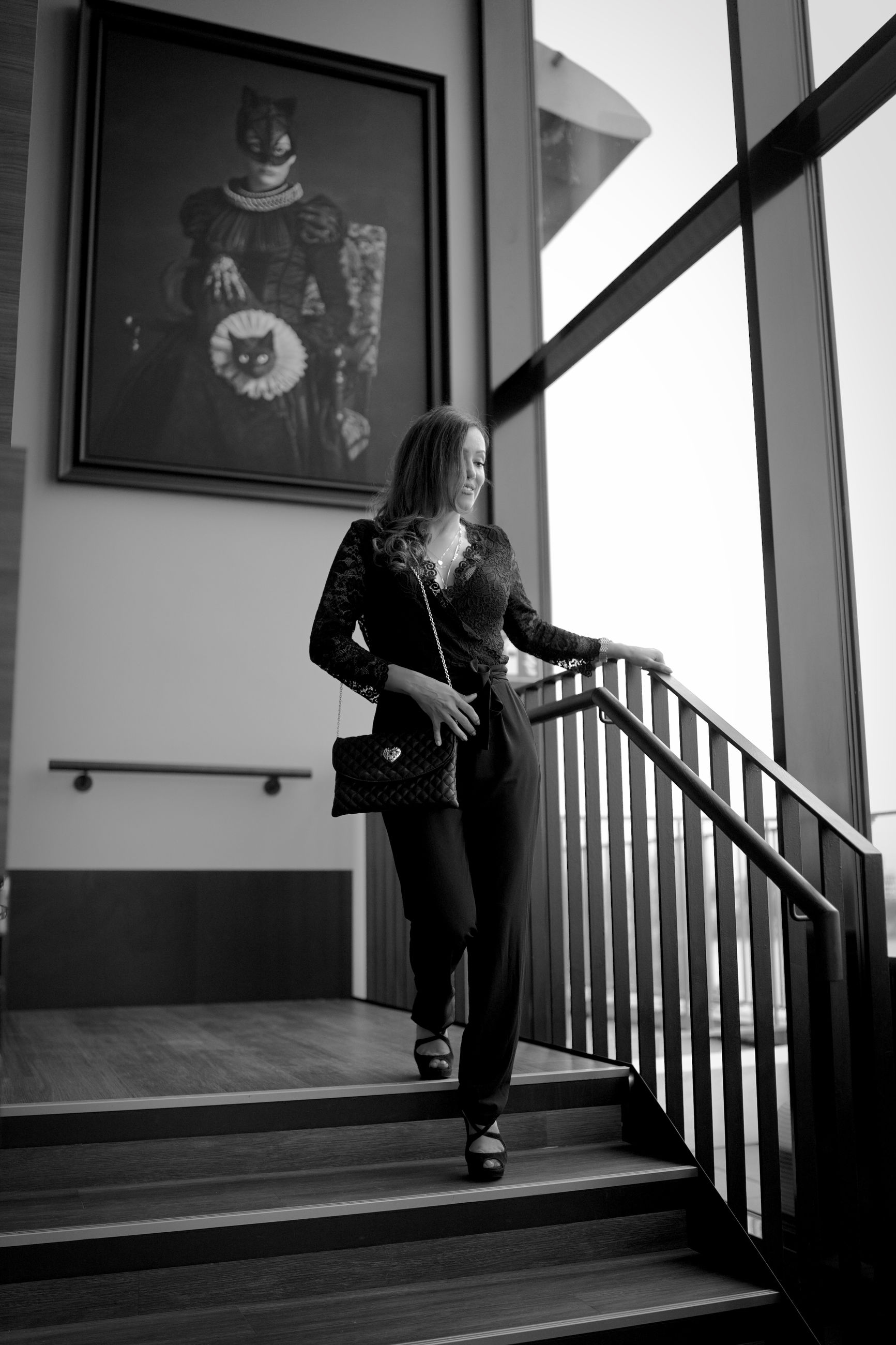 black, white, black and white, one person, full length, monochrome, monochrome photography, women, adult, architecture, indoors, staircase, lifestyles, railing, young adult, female, person, clothing, built structure, standing, footwear, day, steps and staircases, arts culture and entertainment