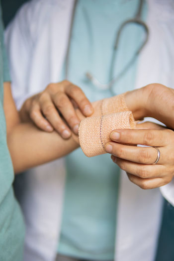 Close-up of woman holding hands