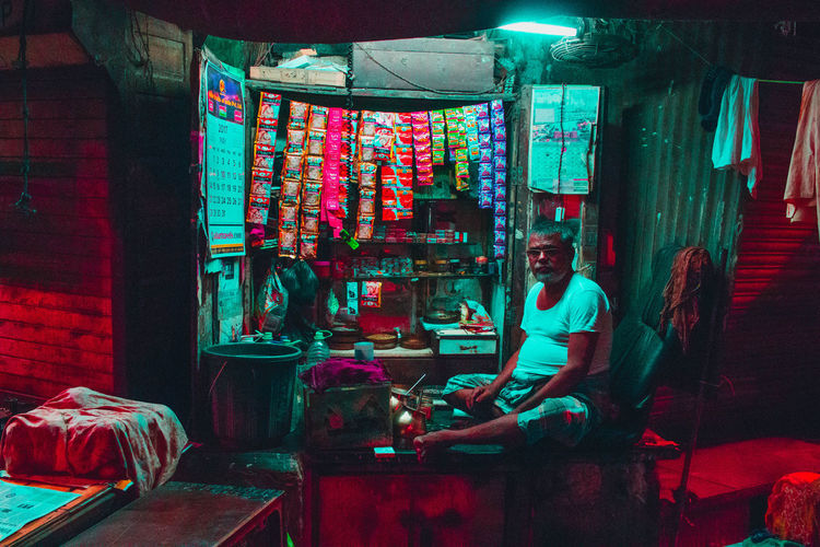 These are all pictures from a series I call Mumbai Noir, where I walk around the city at night through to capture scenes & show the city through my artistic vision. The Creative - 2018 EyeEm Awards Adult Business Casual Clothing Chair Full Length Furniture Illuminated Indoors  Leisure Activity Lifestyles Market One Person Real People Retail  Seat Sitting Small Business Table Young Adult HUAWEI Photo Award: After Dark