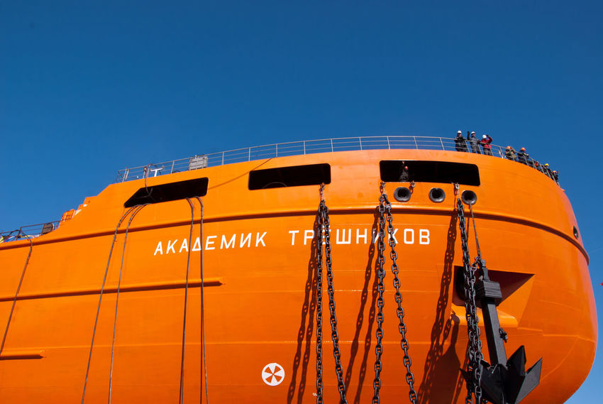 """The launch of the research vessel """"Akademik Tryoshnikov"""" at the St.Petersburg Admiralty Shipyard, March 29, 2011 Anchor Blue Deck Hull Launch Of The Vessel Nautical Vessel Outdoors Research Vesse Shipyard Shipyard Crane Shipyardlife Sky Snow Sunny Vessel Winter"""