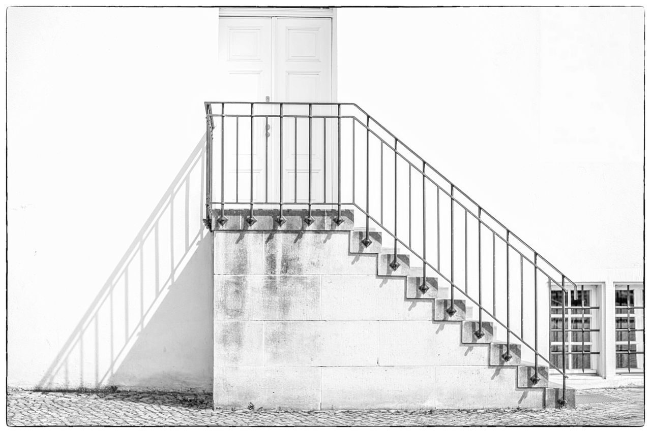 railing, staircase, steps and staircases, steps, architecture, built structure, stairs, hand rail, day, no people, building exterior, outdoors