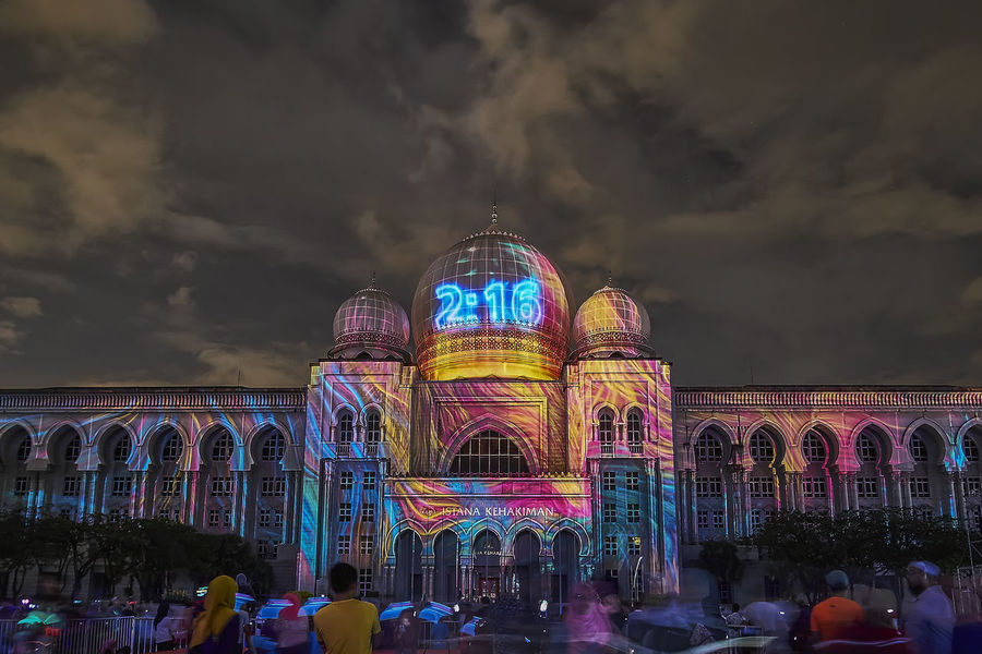 PUTRAJAYA - DECEMBER 31: A colorful projection mapping show with the background view of Palace Of Justice on December 31, 2017 in Putrajaya. Landscape_Collection Arch Architecture Building Exterior Built Structure Cloud - Sky Dome Illuminated Landscape Landscape_photography Large Group Of People Lifestyles Multi Colored Nature Night Outdoors People Projection Mapping Projection Screen Real People Sky Tourism Travel Destinations
