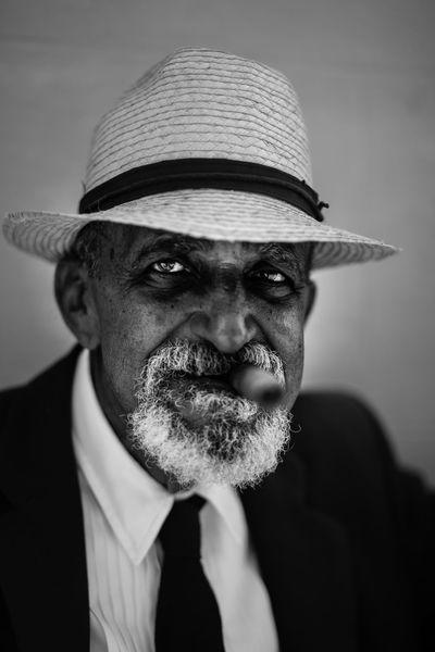 A cuban man poses for tourist' pictures. Close-up Cuba Cuban Front View Havana Cuba Lifestyles Person Portrait Portraits Sigar Straw Hat Trinidad