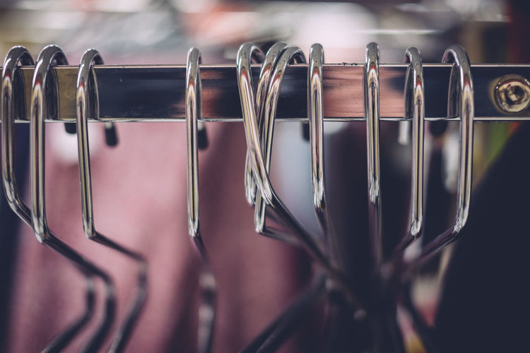 Close up of coathangers hanging on rack