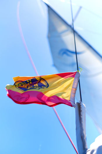 Yachts Ensign of Spain waving in the wind against blue sky background. Sunny weather. Clear Sky Independence Patriotic SPAIN Sign Spanish Waving Waving Flag Yachts Yachts Ensign Blue Sky Boat Day Ensign Europe Fabric Flag Flag Of Spain Flags In The Wind  Nautical Vessel Ship Sunny Day Symbol Vessel Yacht
