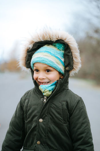 Portrait of boy in snow